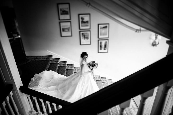 black and white image of gorgeous bride on the Omni Mt. Washington staircase