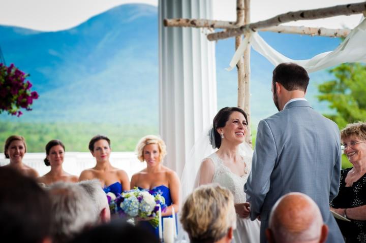 Bride smiles up at handsome groom during their Omni Mount Washington Wedding