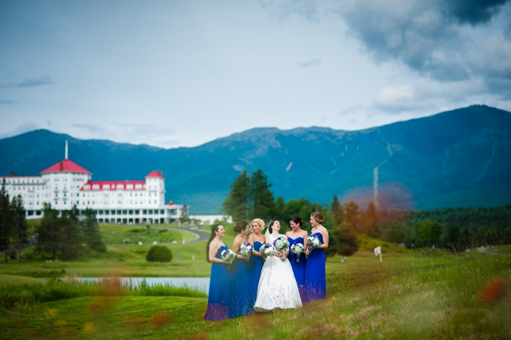 the gorgeous bride and her beautiful bridesmaids giggle during bridal party portraits
