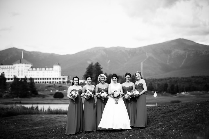 beautiful bride and her bridesmaids look at the camera during their mountain bridal portraits