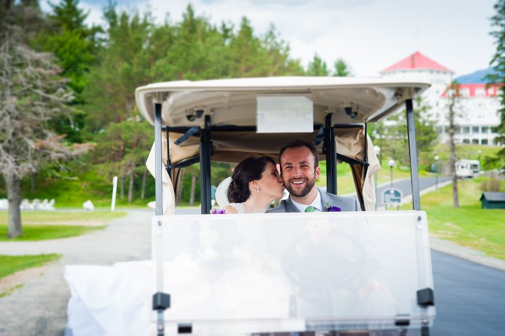 the bride and groom driving a golf cart for some fun couples wedding day portraits
