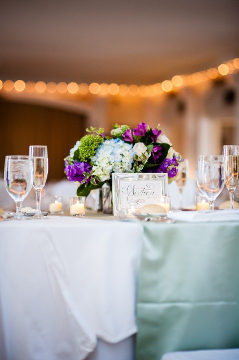 beautiful purple green and blue wedding centerpieces were beautiful for this mountain wedding