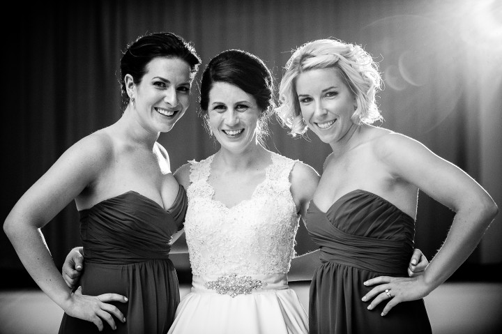 beautiful bride and her two maids of honor pose for a quick portrait