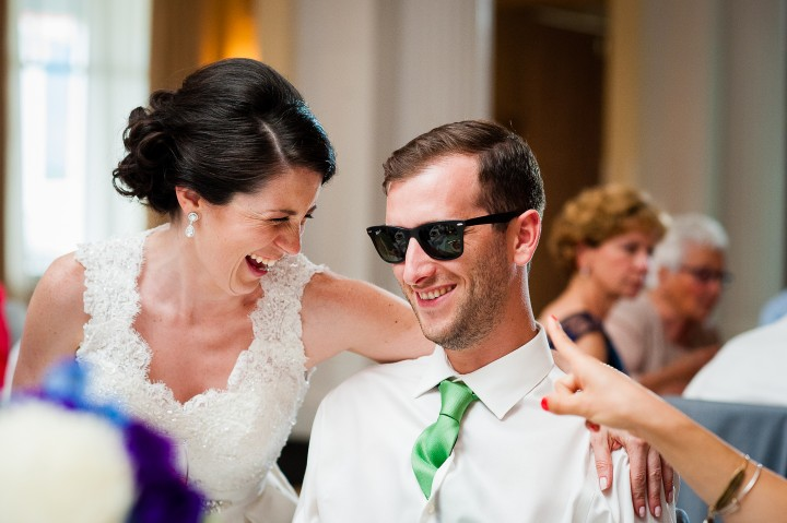 beautiful bride and a groomsmen laughing during the gorgeous ballroom wedding reception