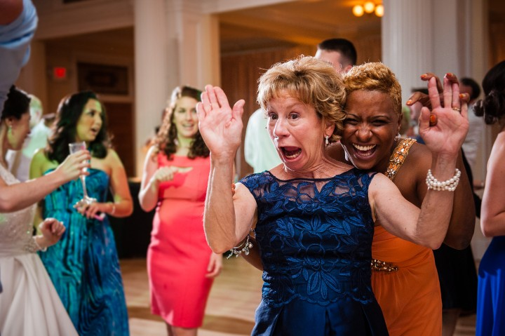 two weddings guests being goofy for the camera on the dance floor of an omni mount washington wedding