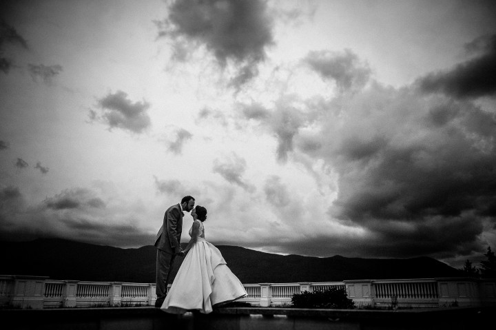 the bride and groom kiss during their mountain wedding portraits