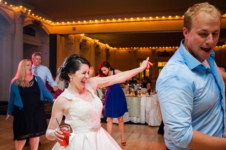 the beautiful bride dances during her fun wedding reception