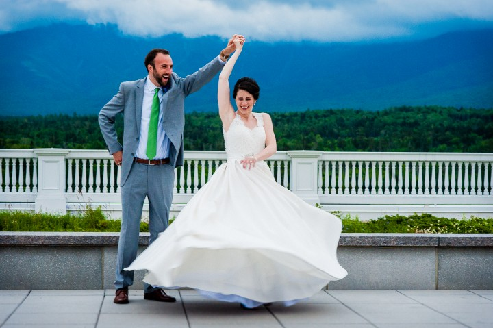 bride and groom showing off their dance moves on the terrance of the stunning mount washington hotel