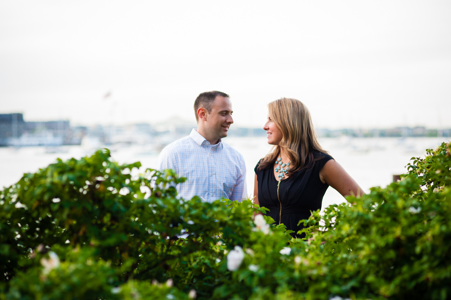adorable couple steals a glance at one another during their engagement session