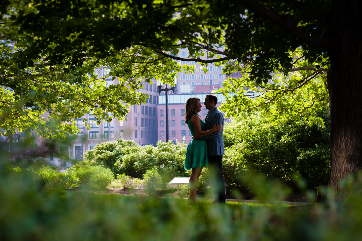 Silhouette of engaged couple under trees