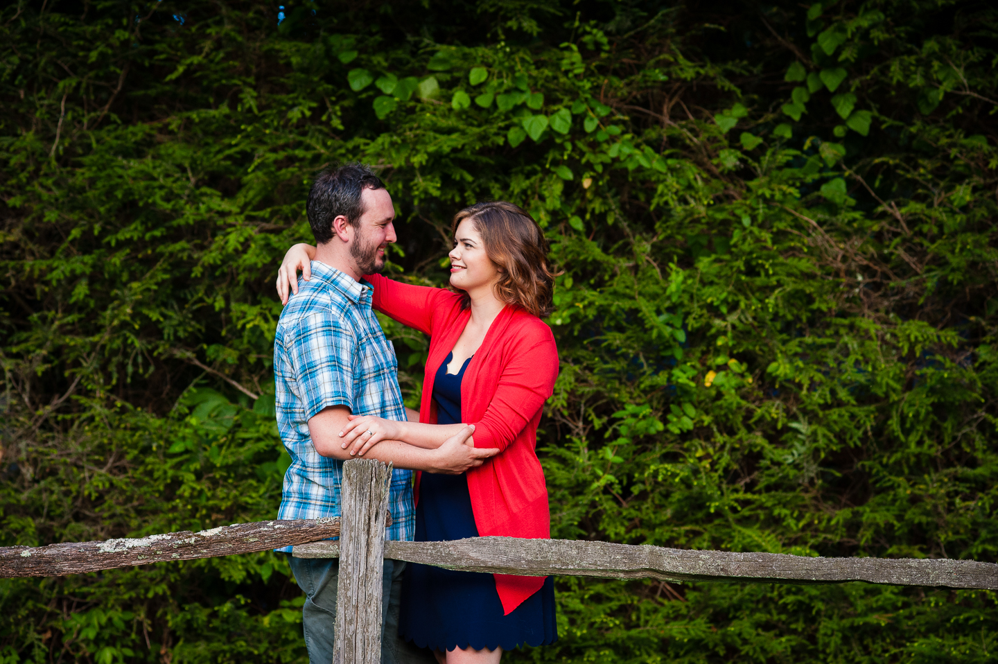 gorgeous young couple steal a glance at each other during their wedding portraits
