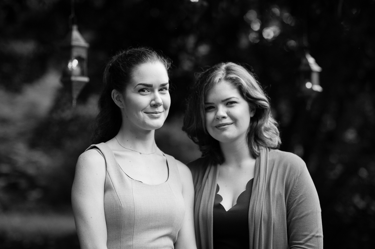 bride and her sister pose for a quick sibling portrait