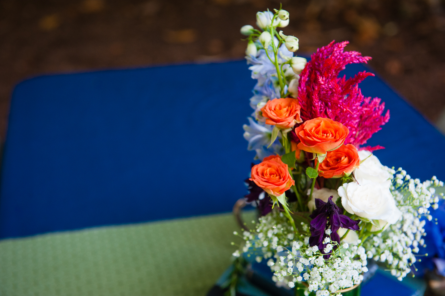 handpicked wildflowers adorned the tables of this beautiful backyard wedding