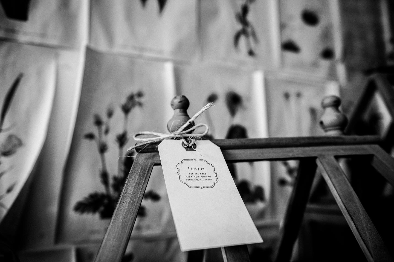 Very creative business tags for Flora an asheville wedding florist