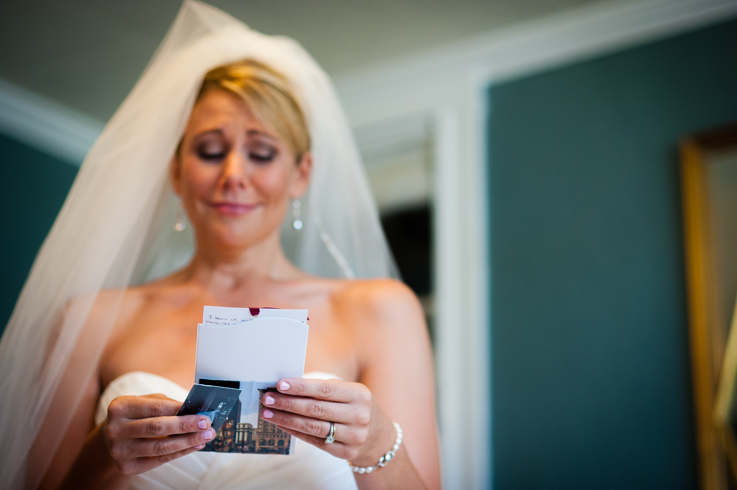 beautiful bride gets emotional as she reads the card from her soon to be husband
