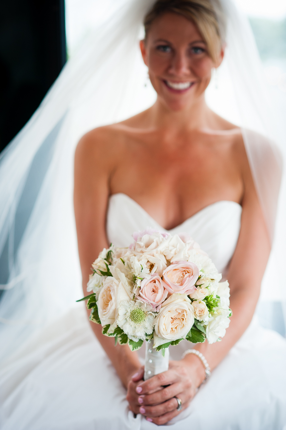 gorgeous bridal bouquet is show off by bride during the trolley ride to her wedding ceremony