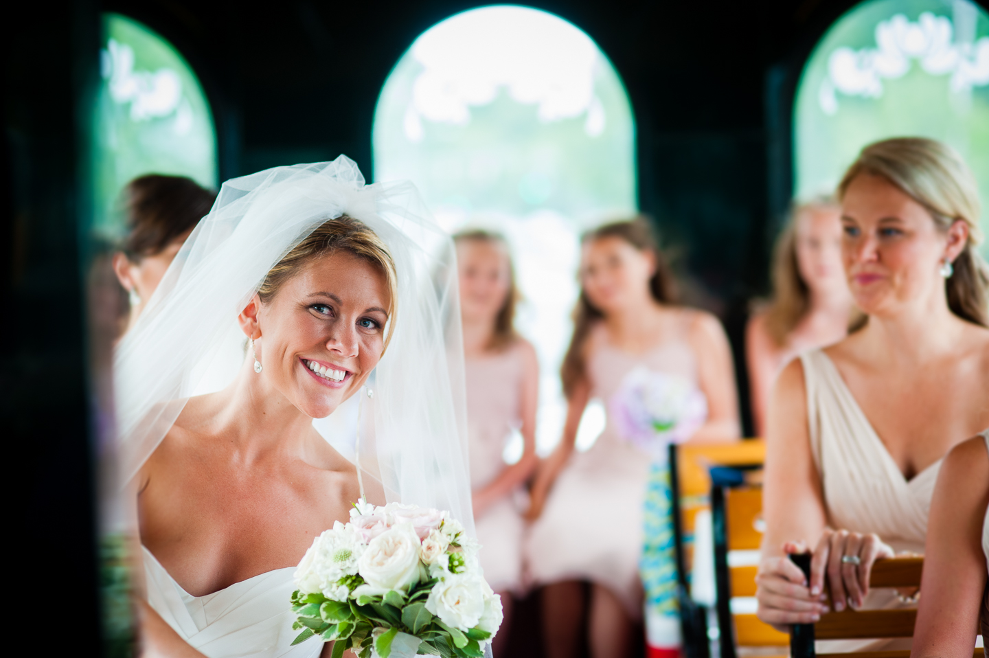 beautiful brides is all smiles during the trolley ride to her wedding ceremony