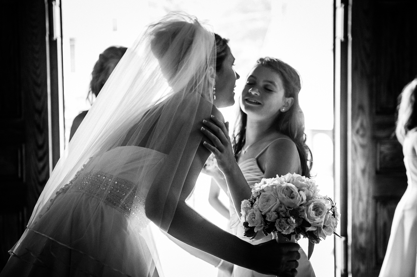 last kisses to her adorable jr bridesmaid before the bride walks down the aisle