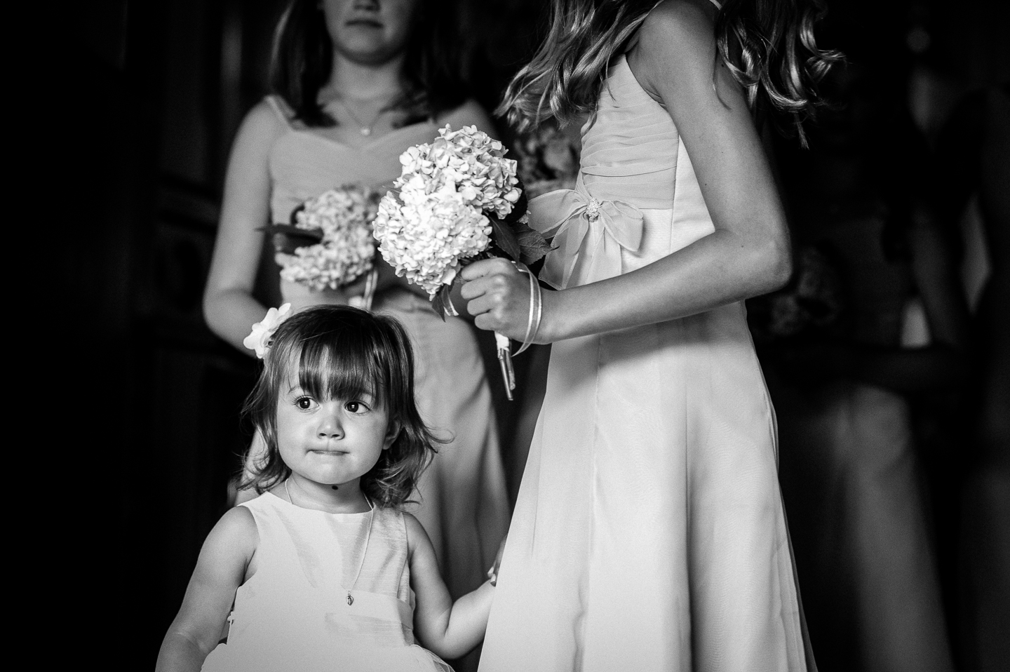 adorable flower girl looks at the aisle she is is soon to talk down