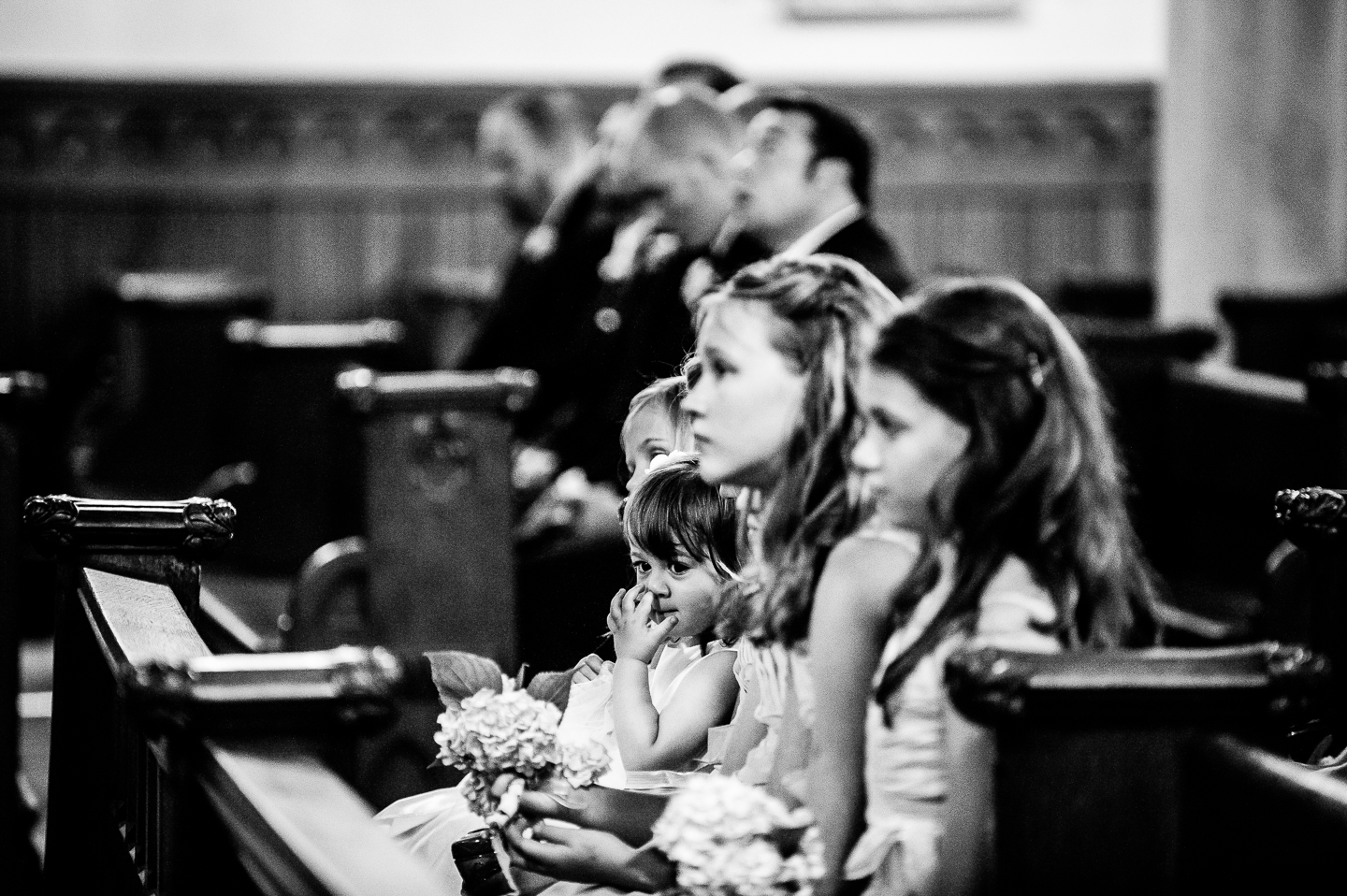 adorable flower girl is caught picking her nose during a long church wedding ceremony