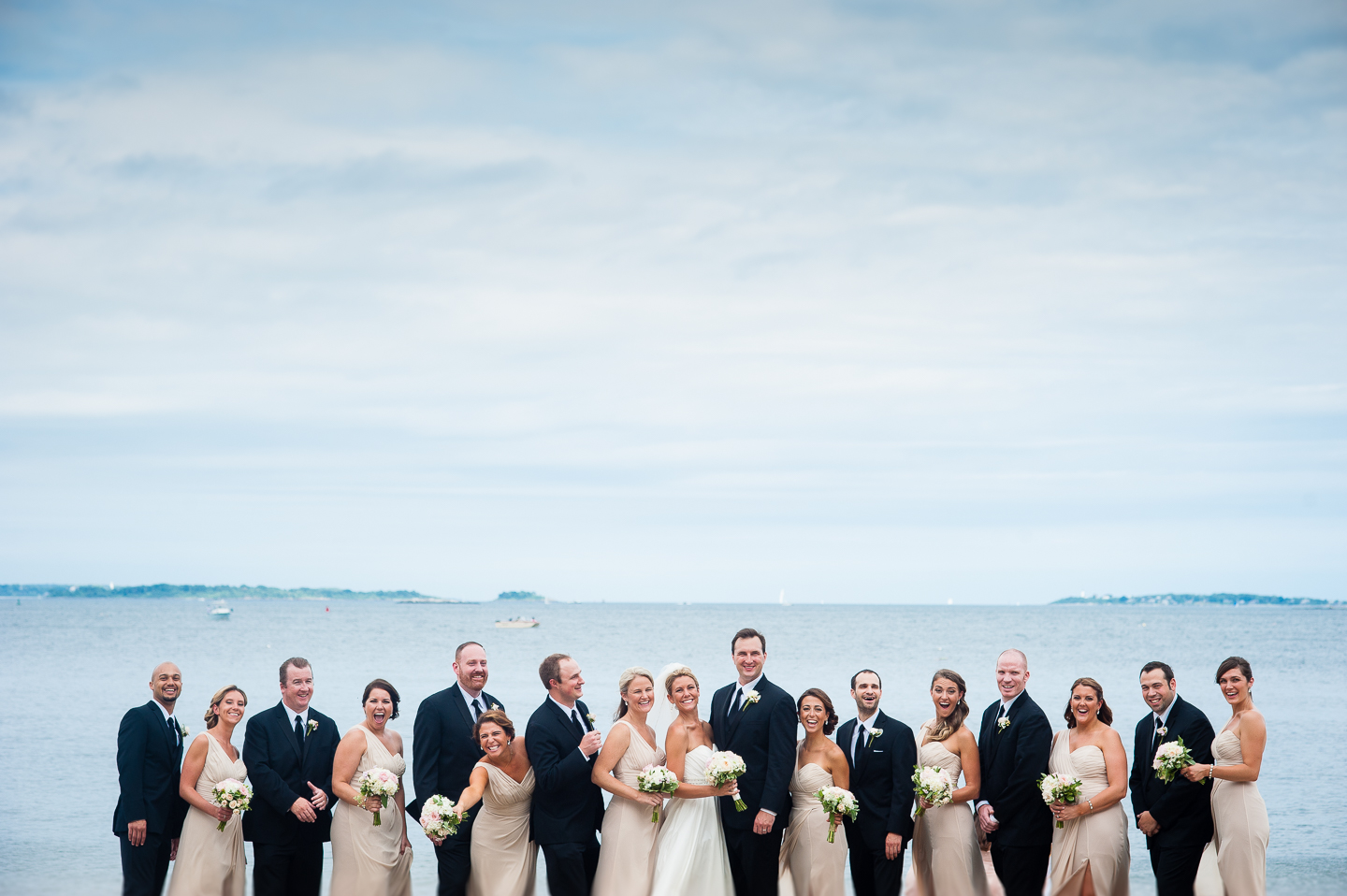 the gorgeous wedding party laughs  for this informal wedding party photo