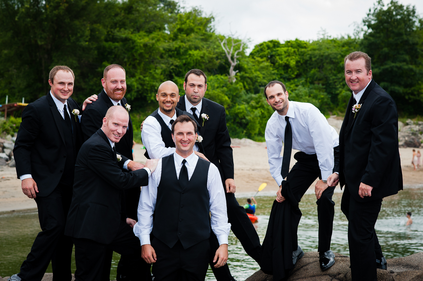 The handsome groom and his guys pose for a fun picture by the ocean