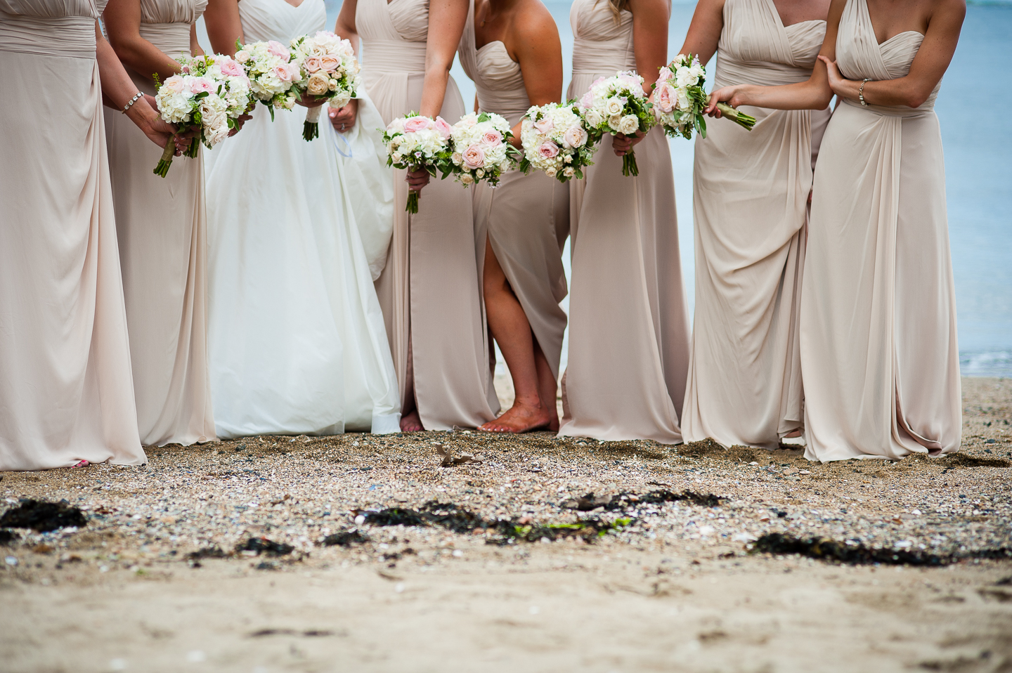 the ladies show off their gorgeous bouquets for this oceanside detail photo