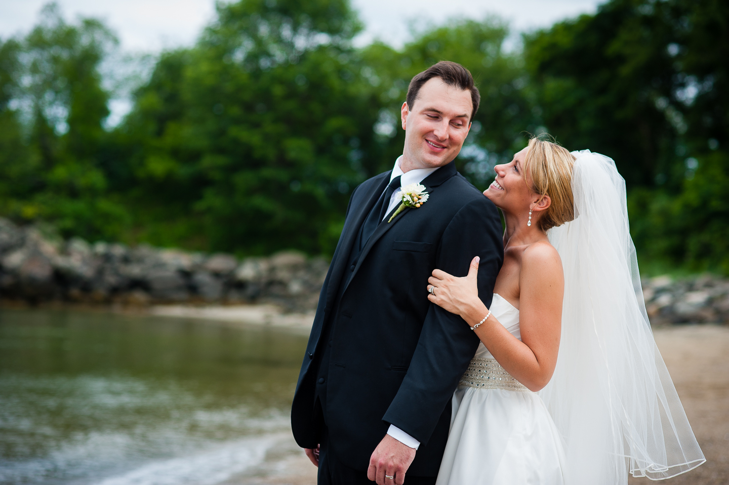an adorable bride and groom look at each other for this couples portrait