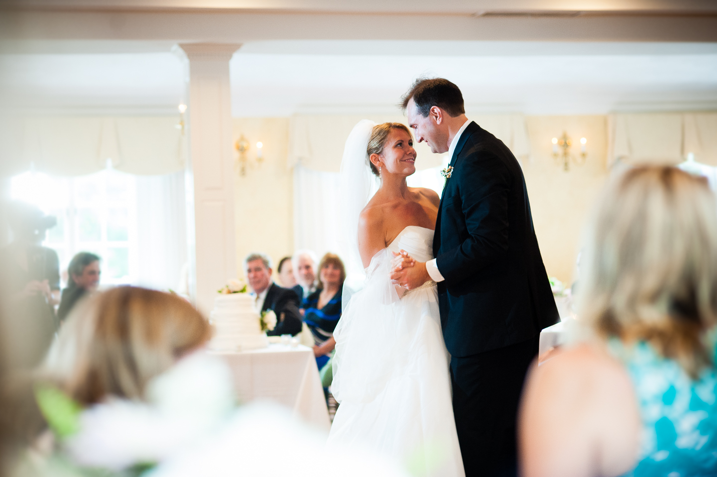 a very sweet moment between the bride and groom during their first dance as husband and wife