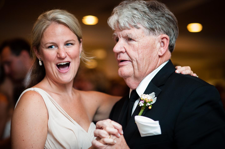 wedding guests dancing during a ballroom wedding reception