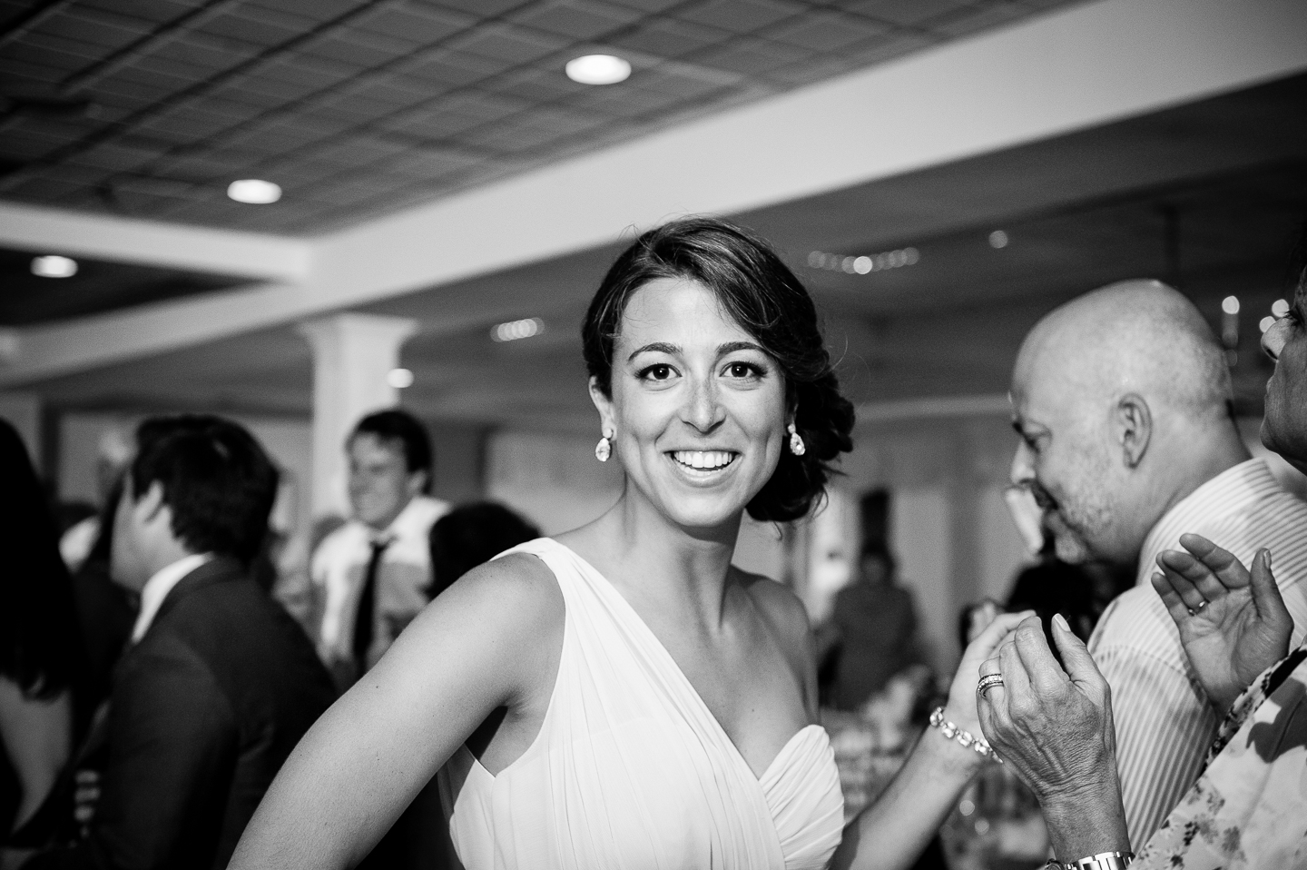 one of the beautiful bridesmaids dancing during this indoor wedding reception