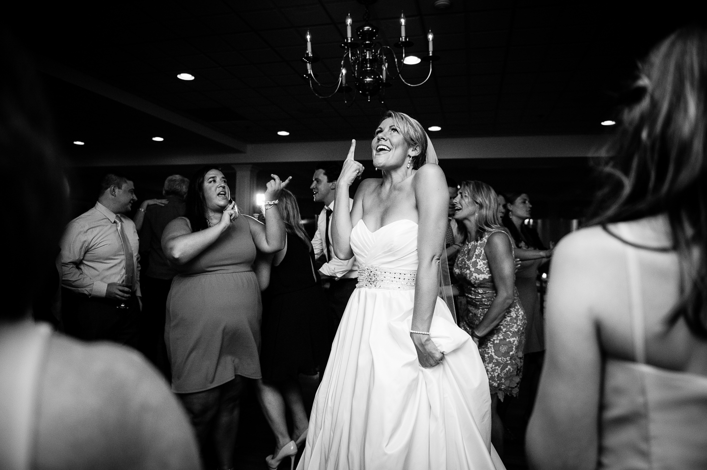 a bride dancing during her evening wedding reception