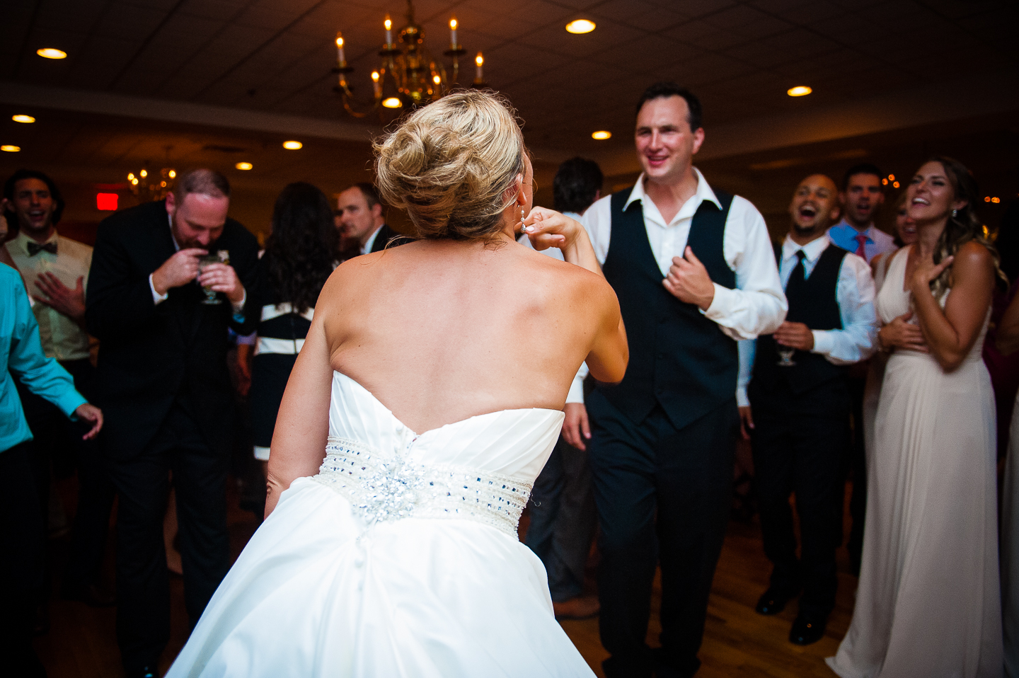 a bride and groom at the center of the dance floor