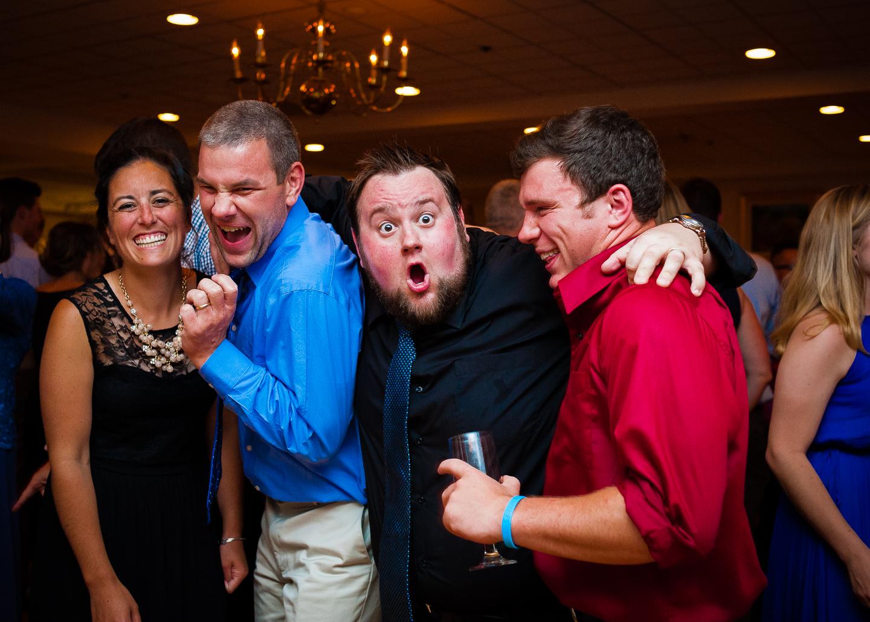 wedding guests goofing off on the dance floor