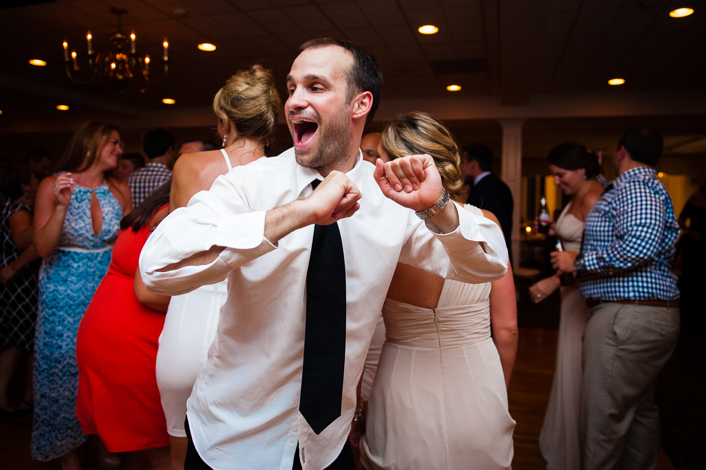 a wedding guest showing off his dance moves