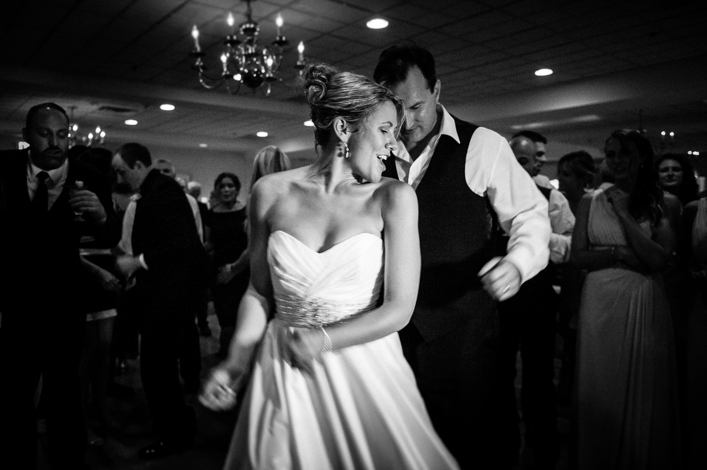 bride and groom dancing at the end of their summer wedding reception