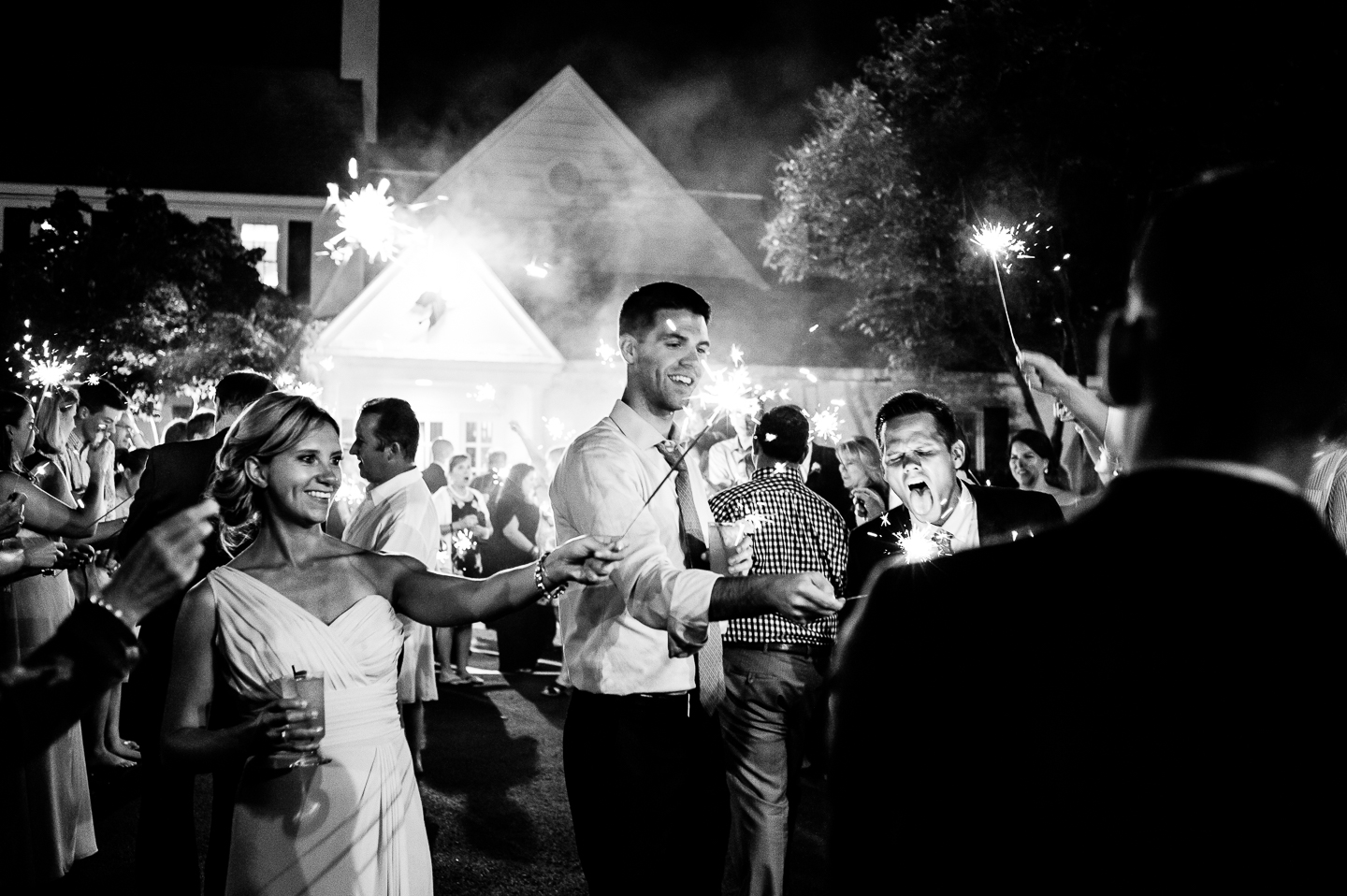 wedding guests lighting the sparklers in preparation for a end of the night sparkler sendoff