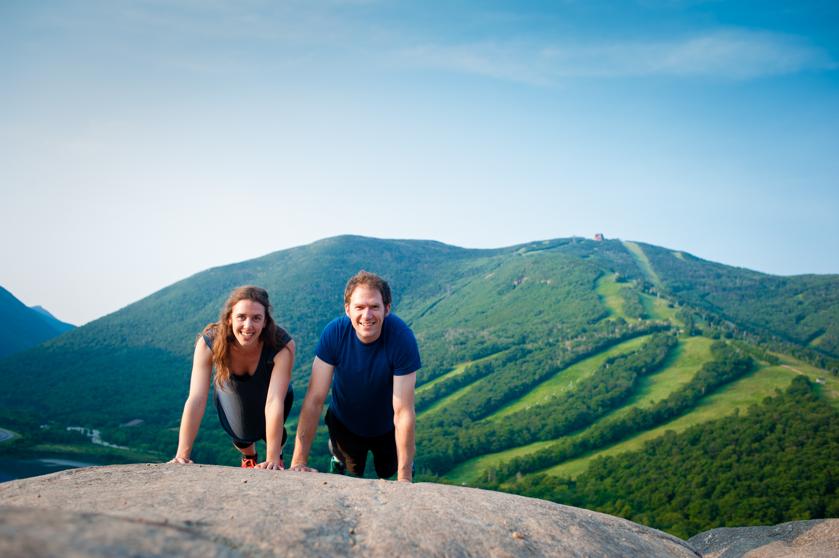 adorable couple battling in a mountaintop push up contest
