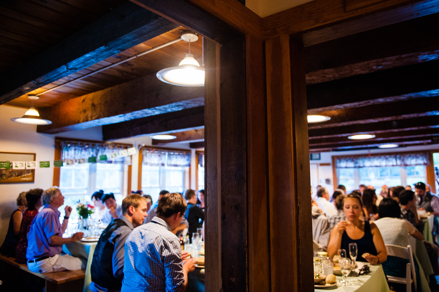 guests sat at long wooden tables during the family style dinner reception
