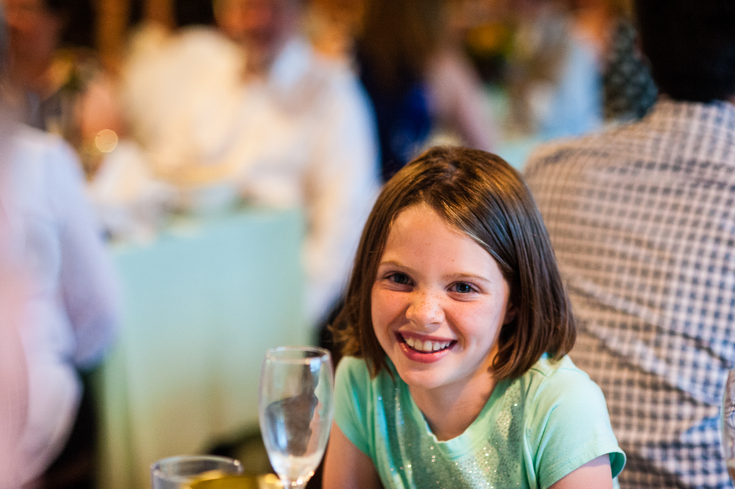 adorable little wedding guest smiling for camera