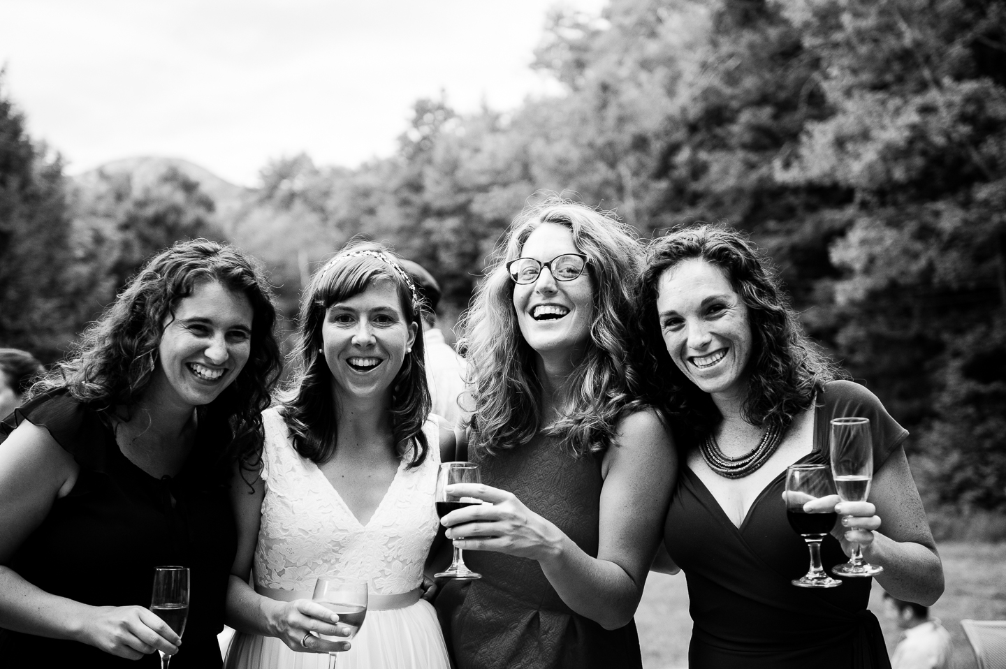 pretty bride and some close friends laughing for a quick photo