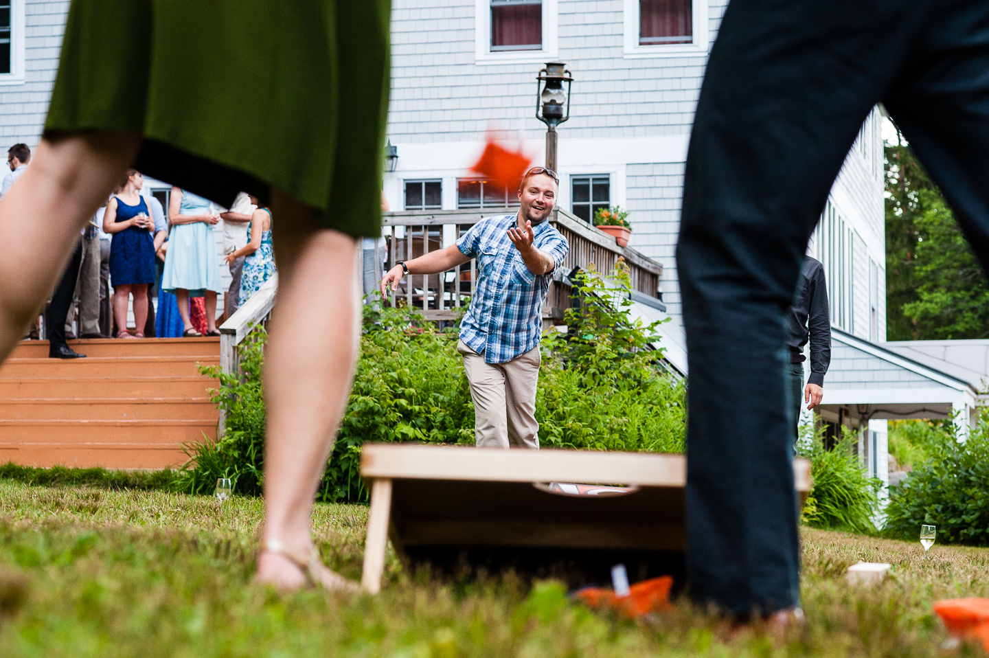 wedding guests played lawn games during this mountain lodge wedding