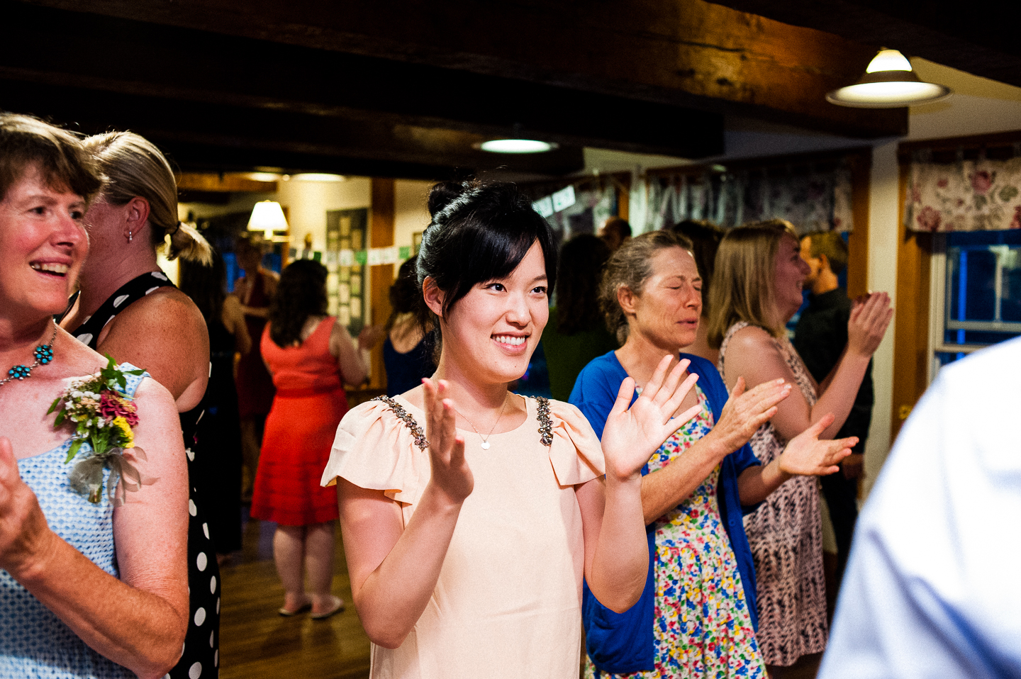 a wedding guests enjoys some contra dancing during this rustic wedding reception