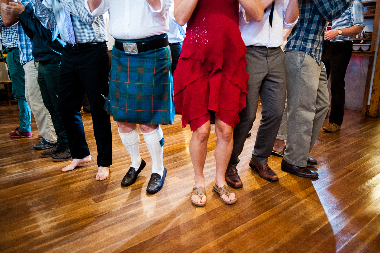 a wedding guest wearing a kilt shows off his moves on the dance floor