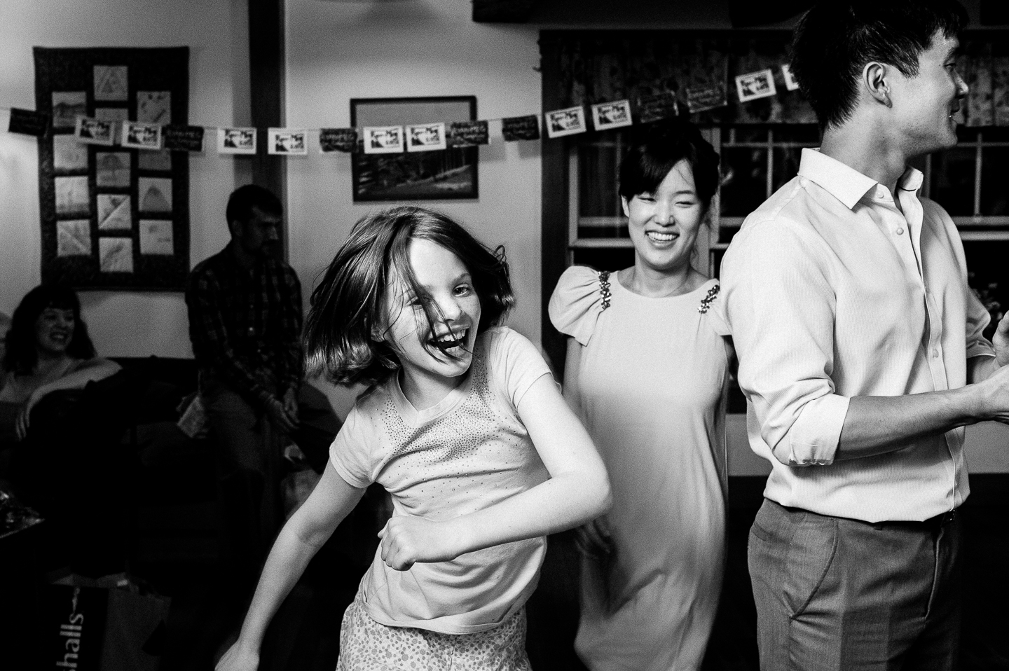 young wedding guest enjoys some contra dancing at a rustic wedding reception