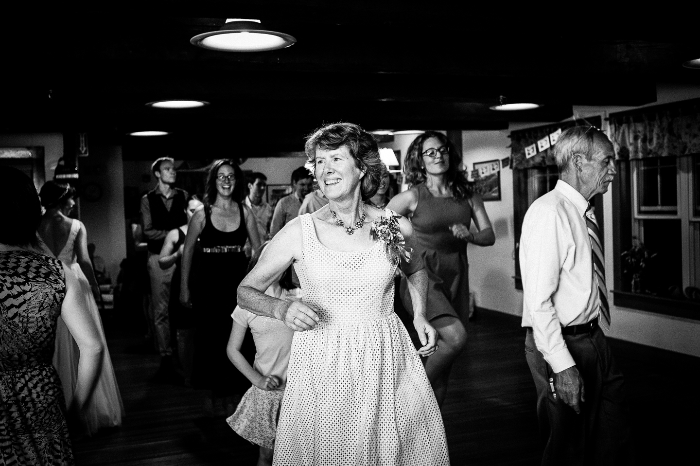 brides mom has fun on the dance floor