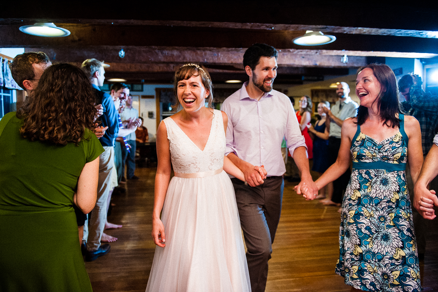 bride and groom were all smiles during their wedding reception
