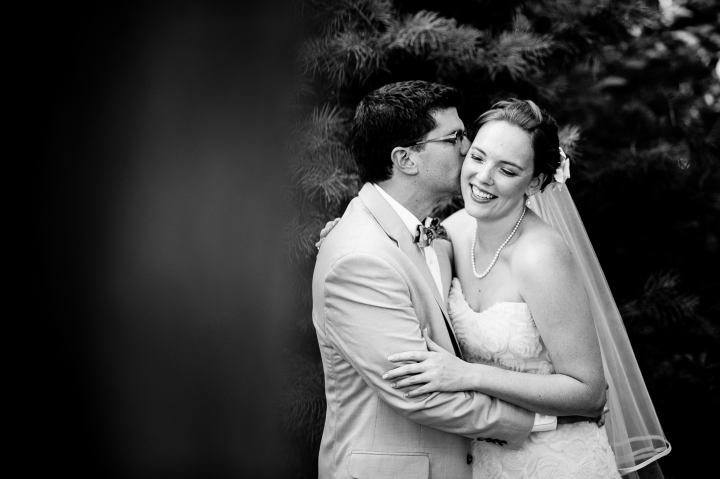 beautiful happy bride and groom embrace during their garden wedding