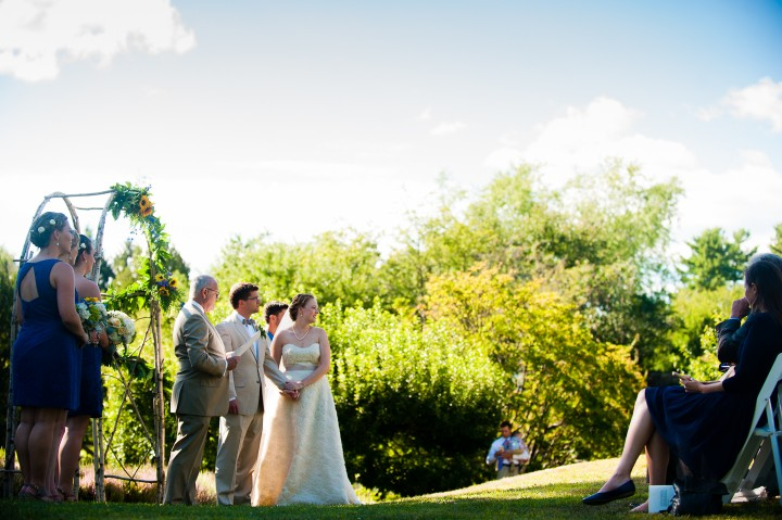 the ceremony took place on a gorgeous hillside overlooking lake sunapee