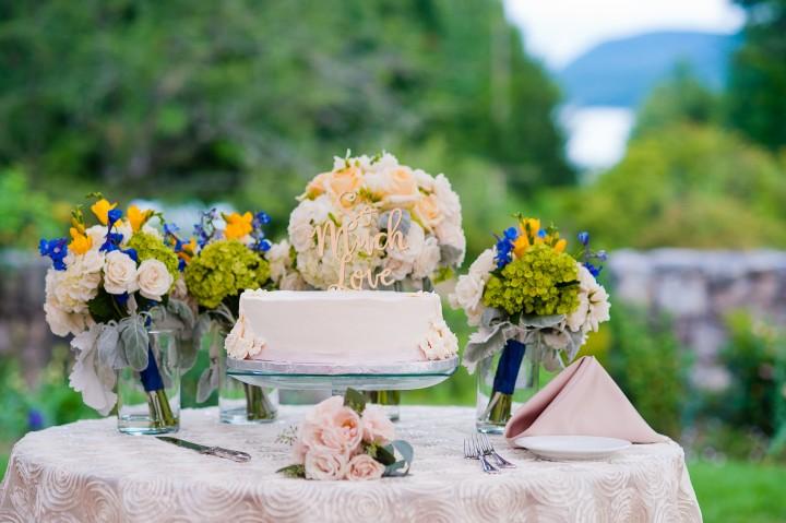 beautiful classic white cake adorned with beautiful fresh flowers